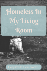 person's feet showing a woman laying on the ground with text overlay homeless in my living room