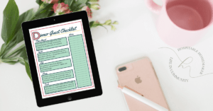 phone with cup and iPad with dinner guest checklist appearing
