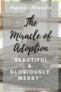 "child playing on floor text overlay : the miracle of adoption ""beautiful & gloriously messy"""