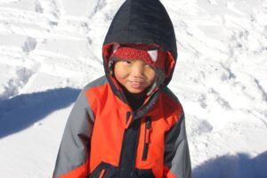 little boy playing in the snow: the miracle of adoption