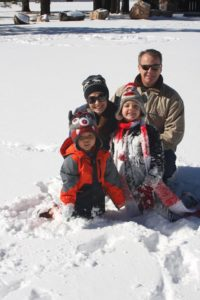 family playing in the snow: the miracle of adoption