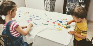 children painting a tablecloth