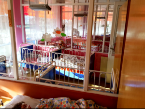 rows of cribs for young child