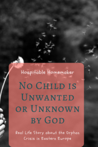 black and white photo of dandelion in the wind with text overlay no child is unwanted or unknown by God