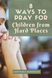 woman in prayer with text overlay that says 8 ways to pray for children from hard places