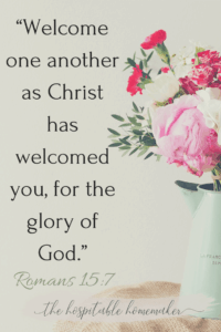 Flowers in a vase with text overlay from Romans 15:7