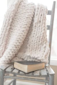 Bible on chair with blanket