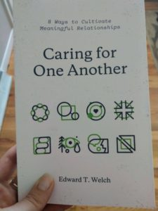 cover of the book caring for one another