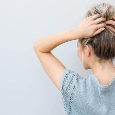 girl putting hair up